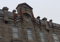 cornice painting on large building